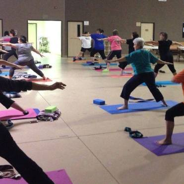 Warrior Two pose being demonstrated in our Beginners Yoga class at Wesley UMC in Nederland, Texas. Yoga near me 77627