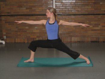 Warrior II, one of the 12 yoga poses for easing osteoporosis