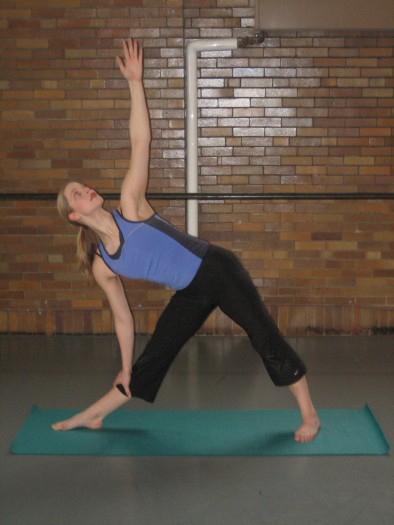 Triangle Pose, one of the 12 Yoga Poses for Bone Strength, and easing osteoporosis