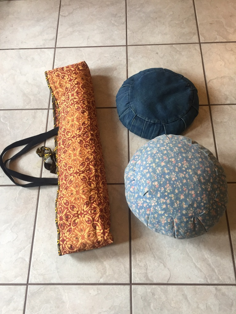 Sewing your own yoga gear. My nice long yoga mat bag from upholstery material, plus yoga straps for the handles. Zafu Meditation seat cushions (pillows) made from denim. I've had the mediation pillows for year, they have held up nicely! Yoga with Gail. 409-727-3177