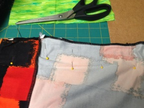 Pin the fabric sides together to prepare to either sew by the machine or hand sew.