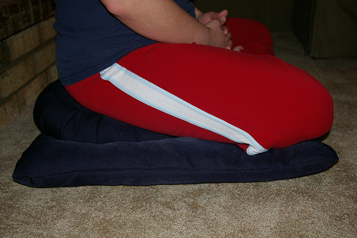 Side view of sitting on the Zafu & Button.  Tilts pelvis forward making for easier seated position.